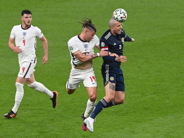 BOTH TOGETHER: Leeds United's England international midfielder Kalvin Phillips, centre, along with West Ham's Declan Rice, left. Photo by Facundo Arrizabalaga - Pool/Getty Images.