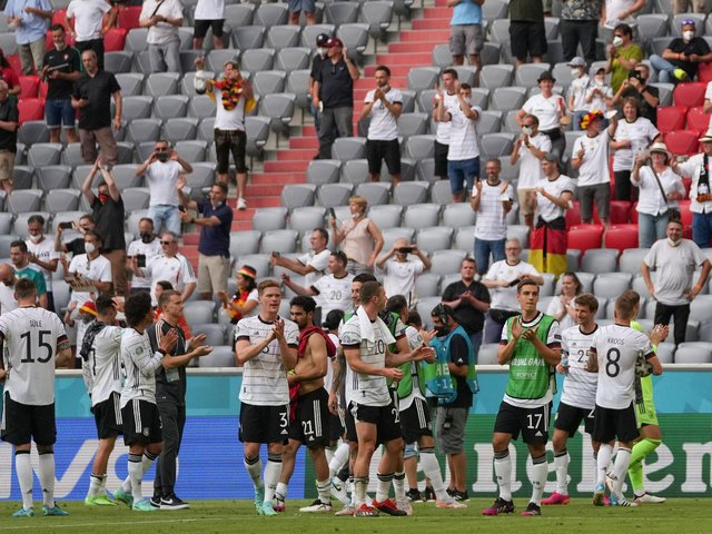 UP AND RUNNING: Leeds United defender Robin Koch, behind no 20 Robin Gosens, centre, applauds the fans after Germany's 4-2 victory against Portugal in Munich. Photo by MATTHIAS SCHRADER/POOL/AFP via Getty Images.