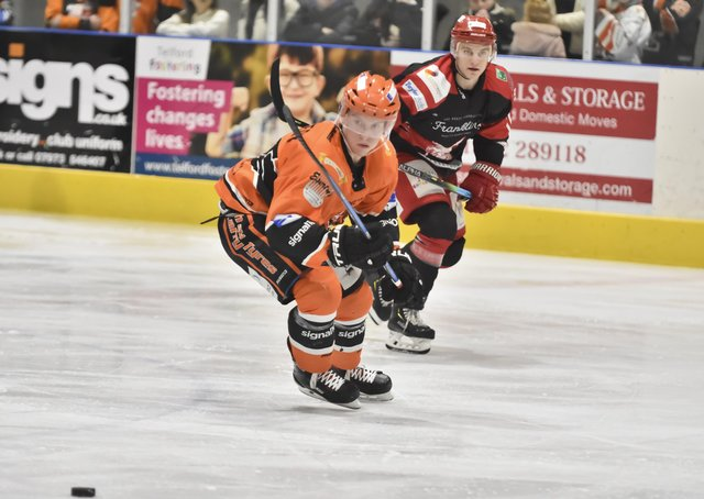 Ross Kennedy chases down the puck during a game between Telford Tigers and Swindon Wildcats in 2019-20. Picture courtesy of Steve Brodie.