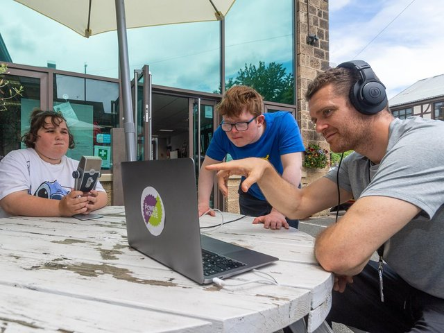 West SILC Power House, based at Springfield Mills,  Farsley. Pictured is student Katie Flanagan, 17, and George Stubbs, 18, with teacher James Paylor, during an outdoor radio lesson.