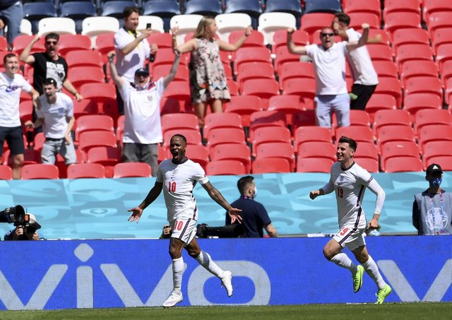 PLAY YOUR PART: England fans cheer as England's Raheem Sterling, left, celebrates with Mason Mount after scoring what proved to be the winning goal against Croatia at Euro 2020 at Wembley. Picture: Laurence Griffiths/AP.