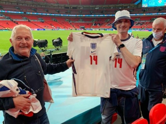 SPECIAL MEMENTO - Leeds United fan Adam Durnin and his dad Alan came away from Wembley with Kalvin Phillips' England shirt.