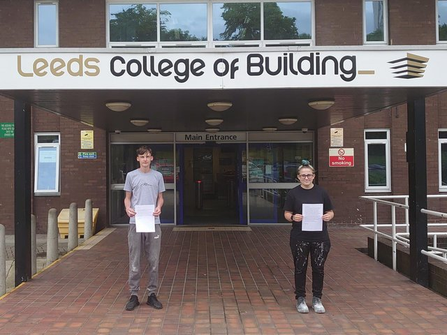 Ben Pratt and Zara Dupont, with their letters from care home residents.