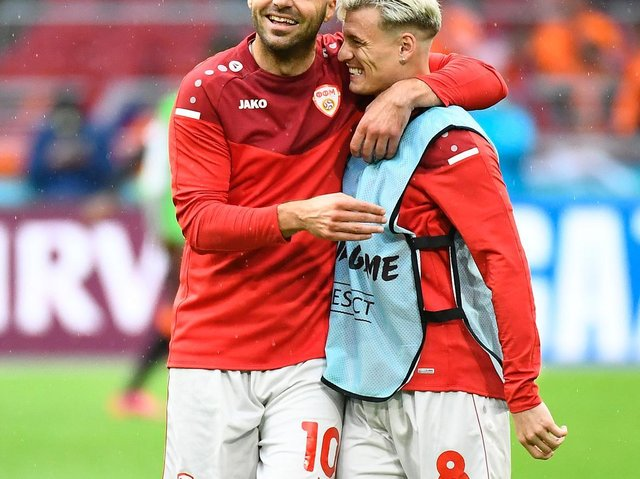 TRIBUTE: From Leeds United's Gjanni Alioski, right, to outgoing North Macedonia team mate and all time record goalscorer Goran Pandev, left. Photo by Piroshka van de Wouw - Pool/Getty Images.