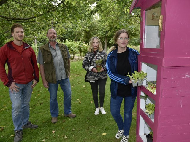 Sarah Priestley of CA Spaces puts plants in the Little Veg Library in Chapel Allerton Park. Looking on are Jamie and Tim Waddington of Leeds Woodcrafters and Angie Talbot of CA_Spaces.