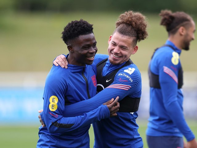 BOTH IN: Gary Neville believes Arsenal's Bukayo Saka, left, and Leeds United's Kalvin Phillips, right, should both start for England against Germany. Photo by Catherine Ivill/Getty Images.