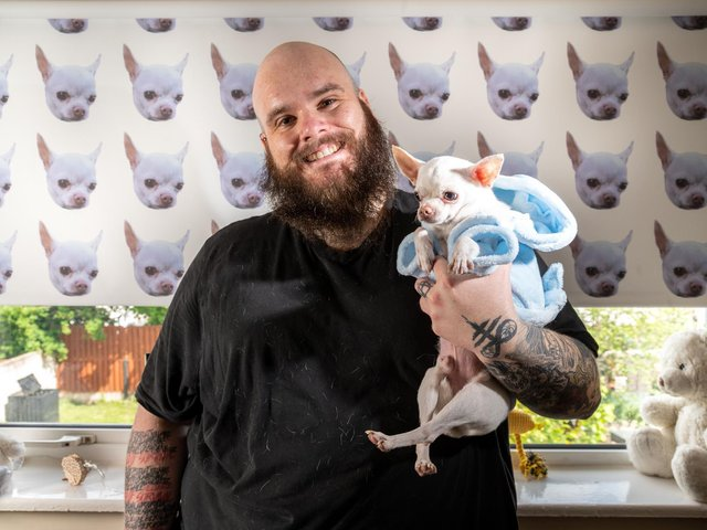 Jon Crowder with his pet chihuahua Wolf.