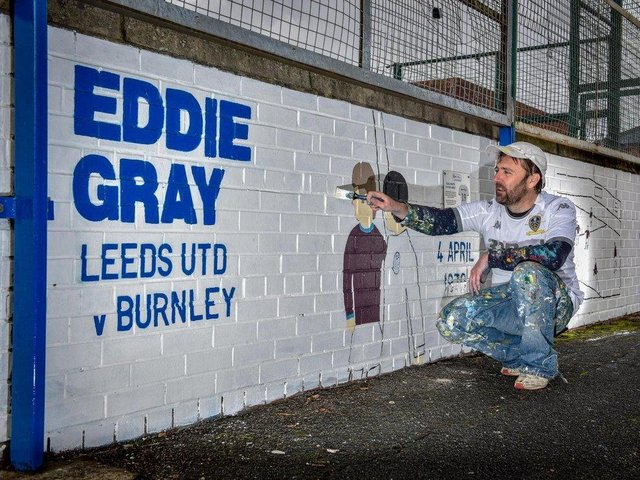 Andy McVeigh with his Leeds United mural of Eddie Gray's iconic goal against Burnley