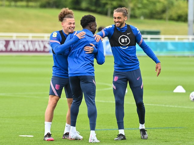 BACKING: Leeds United's England international midfielder Kalvin Phillips, left, with two of the Three Lions attacking players in Bukayo Saka, centre, and Dominic Calvert-Lewin, right, who is yet to feature. Photo by JUSTIN TALLIS/AFP via Getty Images.
