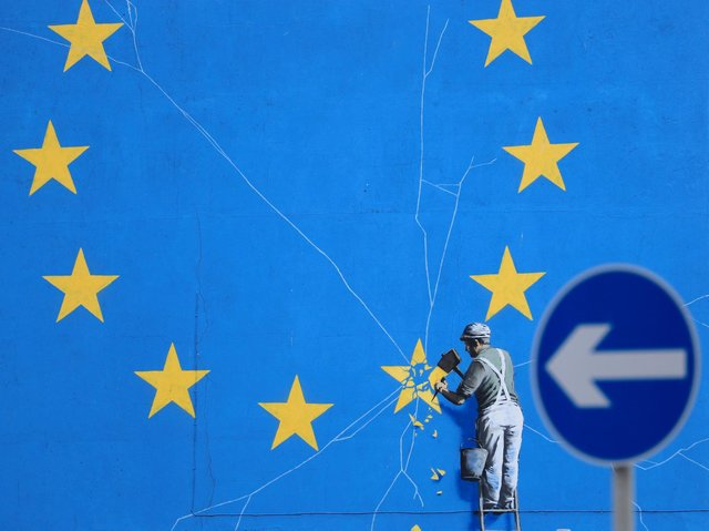 File photo dated dated 29/01/19 of a view of the Brexit-inspired mural by artist Banksy. Wednesday marks five years since the UK voted to leave the EU by 52% to 48% - however, the path out of Europe has been anything but smooth.
