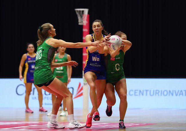 AIMING HIGH: Leeds Rhinos' Fi Toner, right, battles with Celtic Dragons' Christina Shaw, left, and Annika Lee-Jones during a Vitality Netball Superleague clash earlier this season. Picture: Jan Kruger/Getty Images for Vitality Netball Superleague