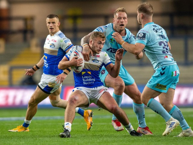 Jarrod O'Connor, with ball, could get a Rhinos recall, but Ash Handley, left, misses out. Picture by Bruce Rollinson.