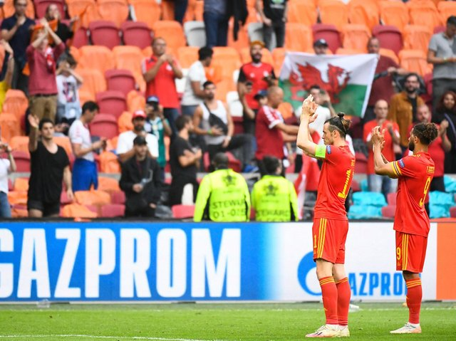 BACK STRONGER - Leeds United man Tyler Roberts, pictured applauding the travelling fans along with Wales team-mate Gareth Bale, insists Rob Page's team can leave Euro 2020 proud of their achievements. Pic: Getty