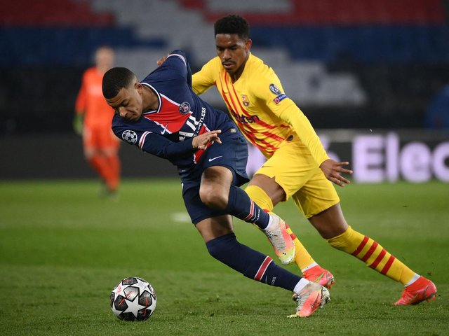 BIG TIME - Leeds United player of interest Junior Firpo in Champions League action for Barcelona against Paris Saint-Germain's Kylian Mbappe. Pic: Getty