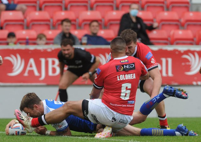 Influential Leeds Rhinos full-back Richie Myler touches down against Salford Red Devils. Picture: Steve Riding.