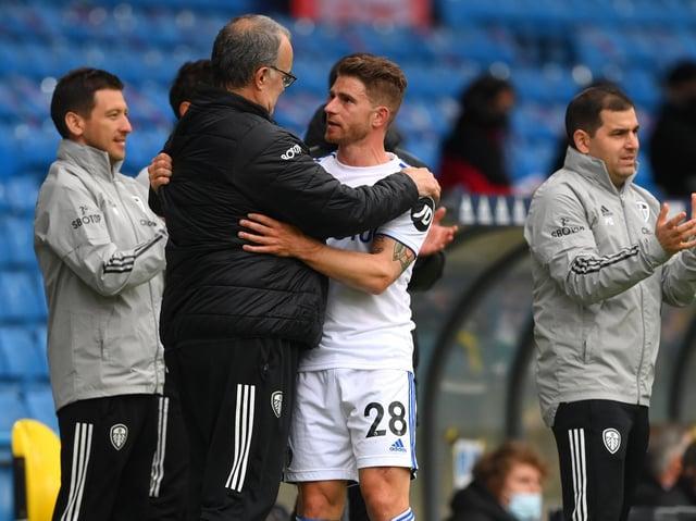 Former Leeds United defender Gaetano Berardi embraces Marcelo Bielsa. Pic: Getty