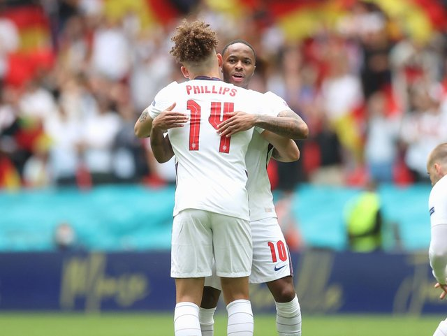 Leeds United's Kalvin Phillips and Raheem Sterling embrace at Wembley. Pic: Getty