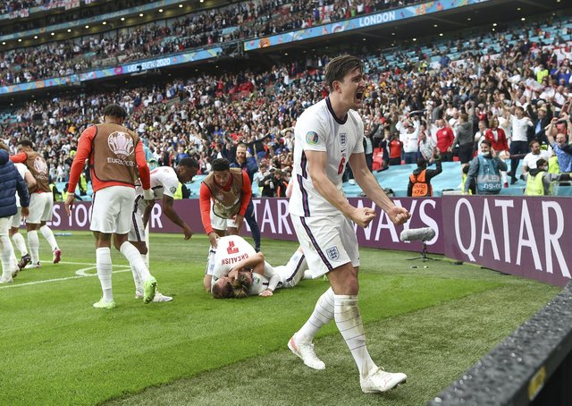 England's Harry Maguire celebrates after Harry Kane scored his side's 2nd goal. (Andy Rain, Pool via AP)