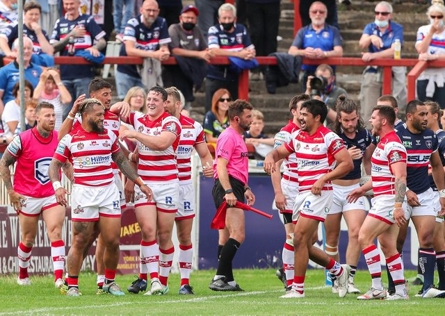 Leigh's Junior Sau is congratulated on his try-saving tackle against Wakefield Trinity earlier in the season. Picture: Alex Whitehead/SWpix.com.