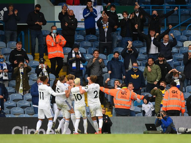 Leeds United fans celebrate with players on the final day of the season against West Brom. Pic: Getty