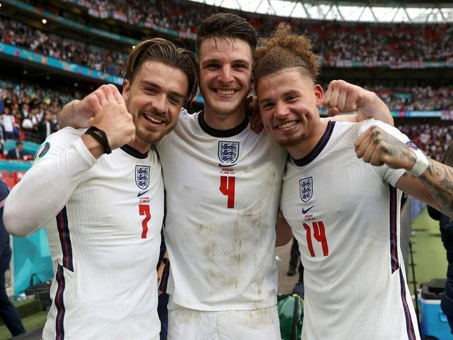 Kalvin Phillips celebrates with Jack Grealish and Declan Rice after the Germany win. (Pic: Getty)