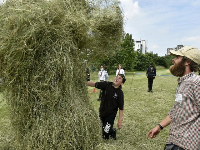 Pupils at the Co-Op Acadamy, Leeds make hay bales at a session run by Meanwood Valley Urban Farm and East Street Arts