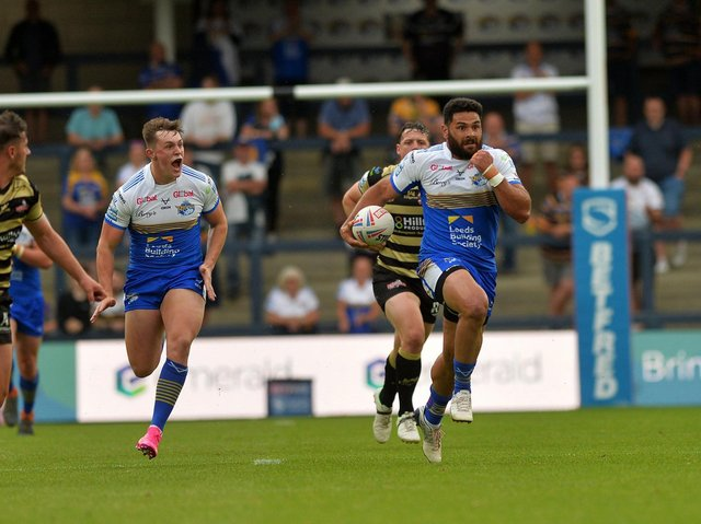 Roared on by teammate Jack Broadbent, Rhyse Martin makes a break against Leigh. Picture by Jonathan Gawthorpe.