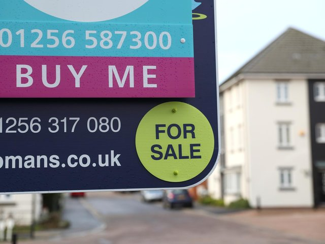 Library image of  a general view of a estate agent's board outside a house for sale