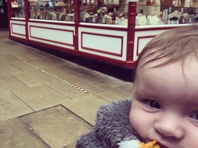 A mum has praised a Kirkgate Market trader for his 'little act of kindness' after he help her teething daughter Aria, six months, by giving her a chunk of dried mango. Photo provided by mum Amy Louise Betteridge.