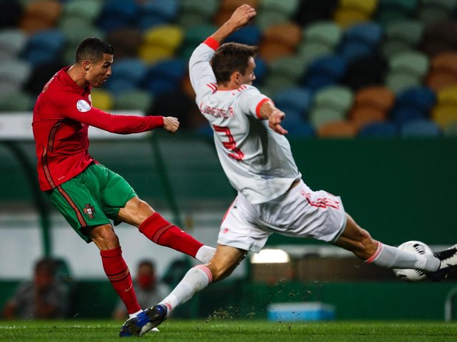 OBVIOUS CREDENTIALS: Leeds United's Diego Llorente, right, kept out Portugal star Cristiano Ronaldo, left, in a goalless draw in Lisbon back in October 2020 but has yet to play a minute for Spain at the Euros. Photo by CARLOS COSTA/AFP via Getty Images.
