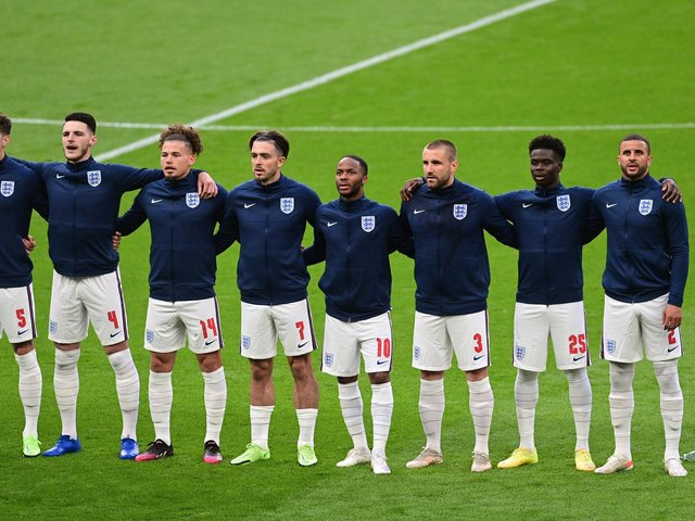 MIDFIELD PARTNERS: England duo Declan Rice, second left, and Kalvin Phillips, third left, are arm in arm for the national anthem prior to the group stages finale against Czech Republic at Wembley. Photo by Neil Hall - Pool/Getty Images.