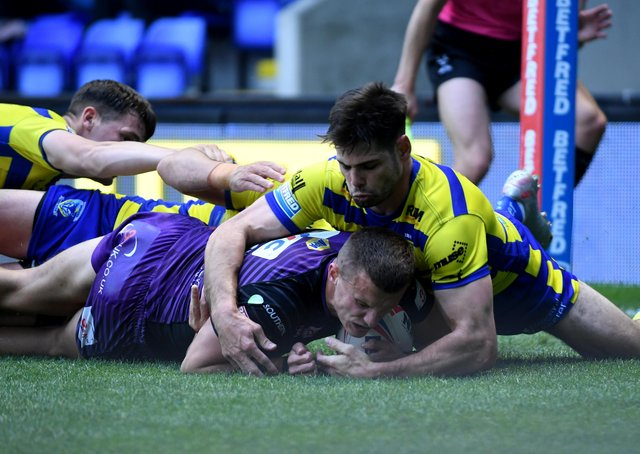 Handy: Rhinos winger Ash Handley gets the ball down for a try against Wolves. Picture: Simon Hulme