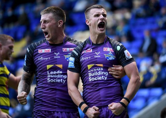 Victory roar: Leeds Rhinos try scorers Alex Mellor, left, and Ash Handley, celebrate Handley's score. Picture: Simon Hulme