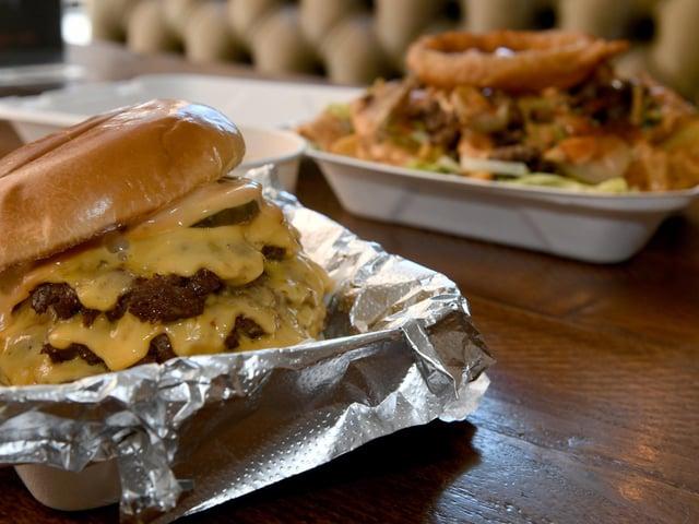 'The Big' burger at Big Buns. A triple patty dry aged smash patty. Photo: Gary Longbottom