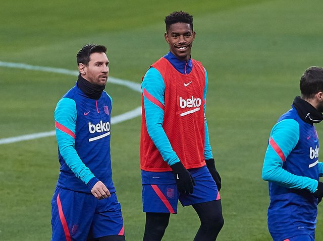 Barcelona star Lionel Messi training with Leeds United's newest defender Junior Firpo. Pic: Getty