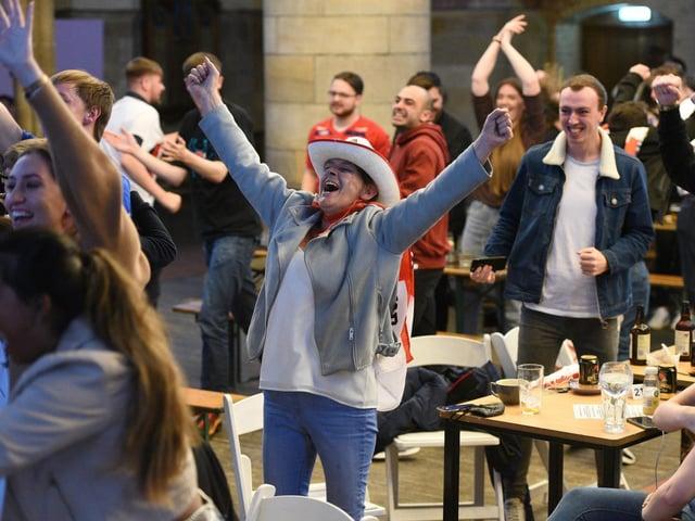 Cheering fans celebrate as England beat Denmark 2-1. (Guzelian)