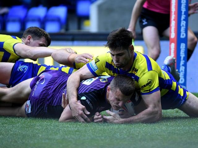 Ash Handley scores against Warrington. Picture by Simon Hulme.