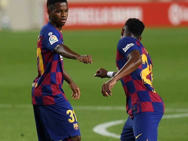 MESSAGE: From Barcelona and Spain teen sensation Ansu Fati, left, to new Leeds United left back Junior Firpo, right. Photo by Alex Caparros/Getty Images.