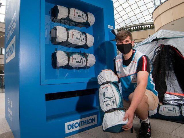 Alexander Terry from Decathlon with the tent vending machine.