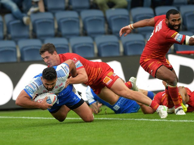Rhyse Martin scores against Catalans. Picture by Jonathan Gawthorpe.