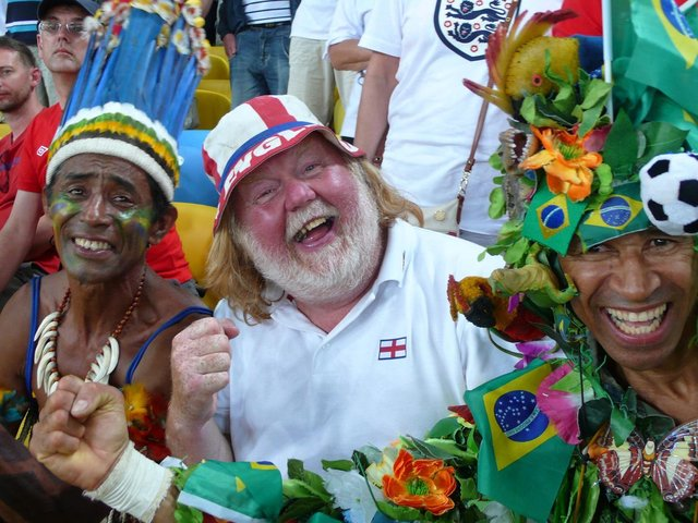 WISH YOU WERE HERE: Yorkshire Evening Post photographer Steve Riding, centre, has clocked up some serious air miles supporting England, including two trips to Brazil, above.