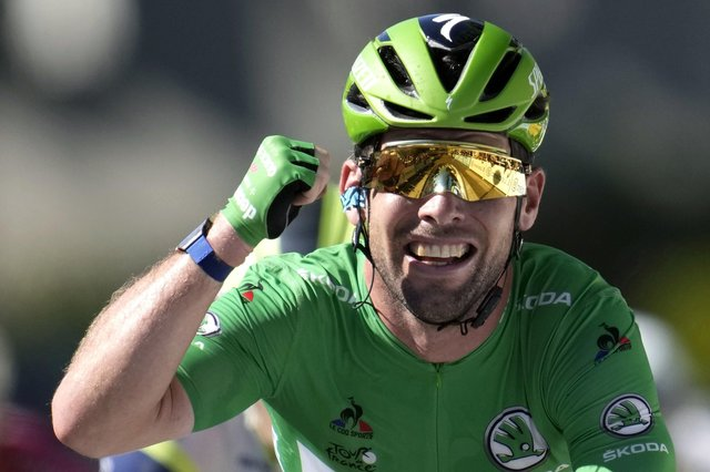 Record equaller: Mark Cavendish celebrates winning his 34th stage of the Tour de France to pull alongside Eddy Merckx. Picture: Christophe Ena/AP