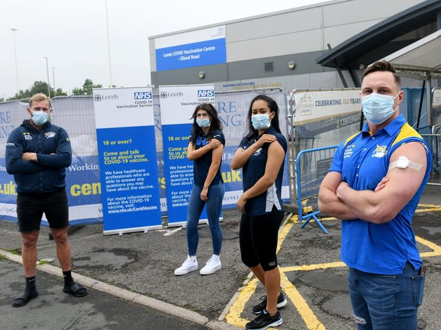 Leeds players Matt Prior, left and James Donaldson, right, were vaccinated at Elland Road, along with women's team star Elle Frain, second from left and Rhinos netball ace Brie Grierson. Picture by Gary Longbottom.