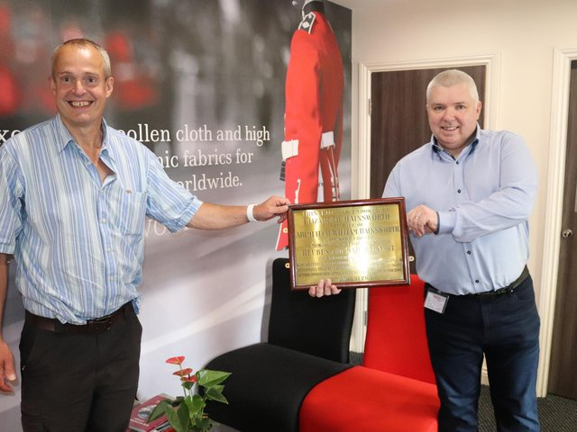 Adam Hainsworth, left, director of Hainsworth, pictured receiving the brass plaque for safe-keeping from Ronie Walsh, receptionist and keen historian at Leeds Teaching Hospitals NHS Trust.