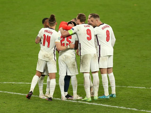 England players comfort Bukayo Saka at Wembley after penalty miss. Pic: Getty