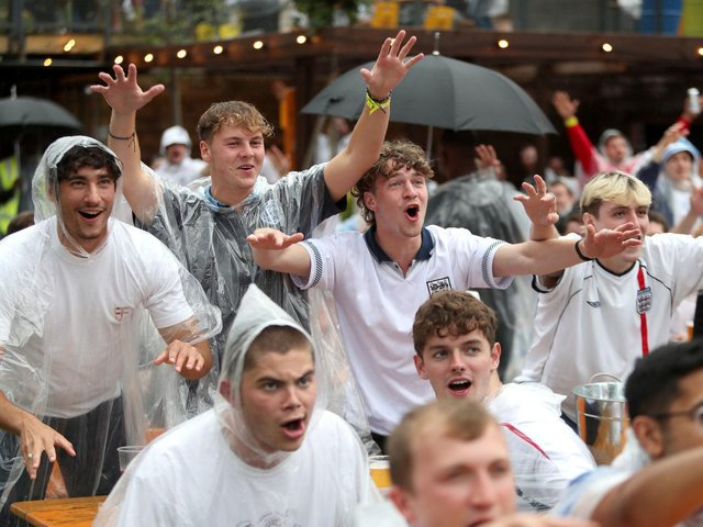 The threat of rain is not dampening the spirits of any football fan tonight. Picture PA Wire