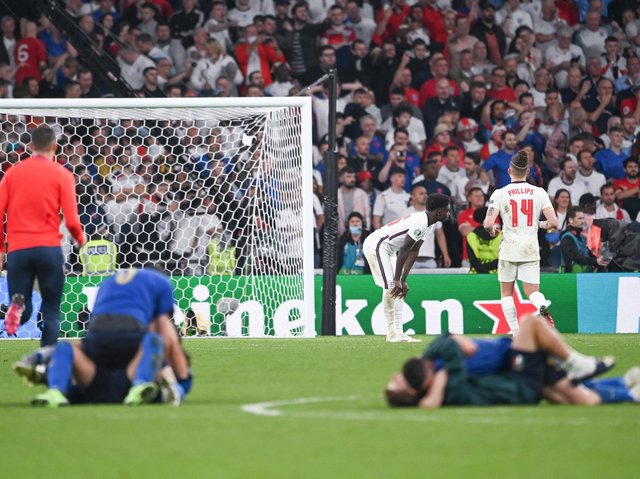 WEMBLEY PAIN - England were beaten on penalties by Italy at Wembley in the Euro 2020 final. Leeds United's Kalvin Phillips consoled Bukayo Saka of Arsenal who missed from the spot. Pic: Getty