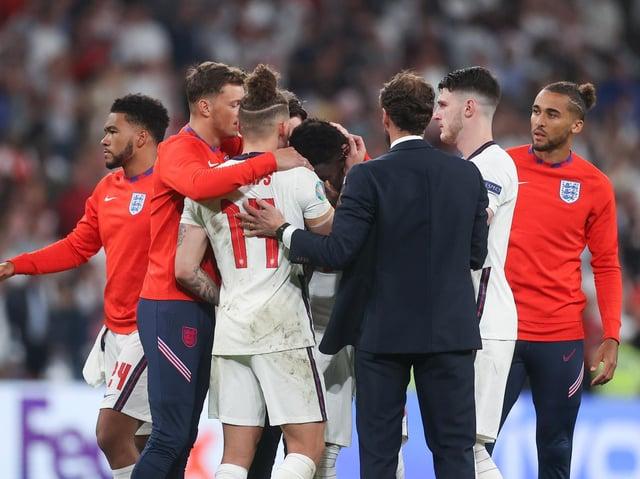 Leeds United's Kalvin Phillips comforts Bukayo Saka at Wembley. Pic: Getty