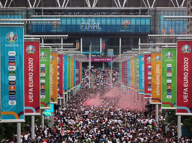 Fans gather outside of Wembley stadium ahead of England v Italy. Pic: Getty
