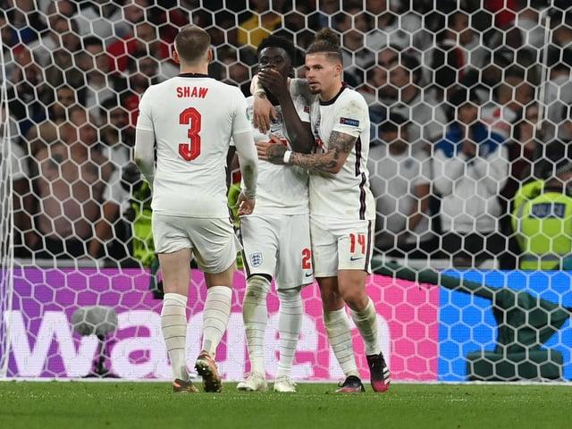 England's Kalvin Phillips comforts Bukayo Saka following his penalty miss at Wembley. Pic: Getty